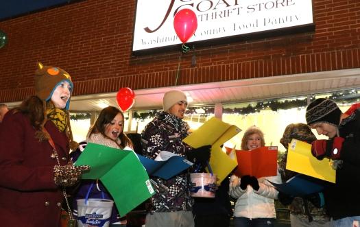 National Honor Society members singing Christmas carols in  front of Joseph's Coat.