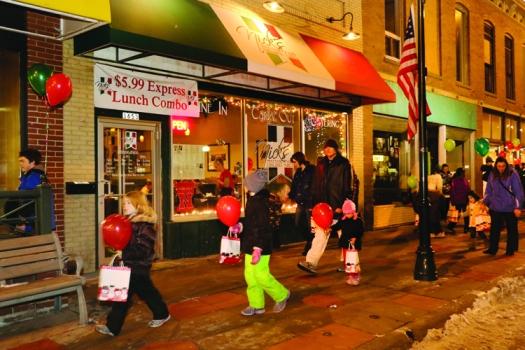 Families strolling along Washington Street.