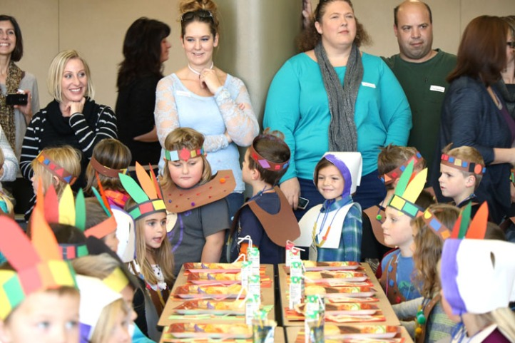 Parents watch as Deerfield and West kindertan students enter the cafeteria in Pilgrim and Native American dress.