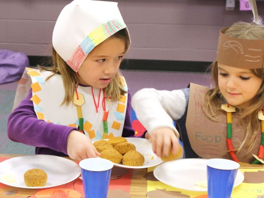 Josei Kros passes a plate of pumpkin muffins that the students made themselves for their Thanksgiving Feast.