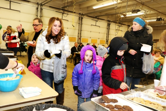 From left, daughter Hadly,  mom Kari Schueth, daughter Jacy,  Madeline, Thomas and mother Jennifer Chikos  pickup soup and desserts at the South Fire Station.