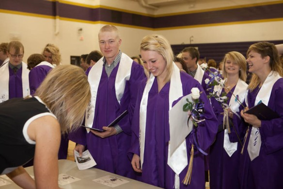 Grant Kubie and Amanda Lambrecht pick up their diplomas following commencement.