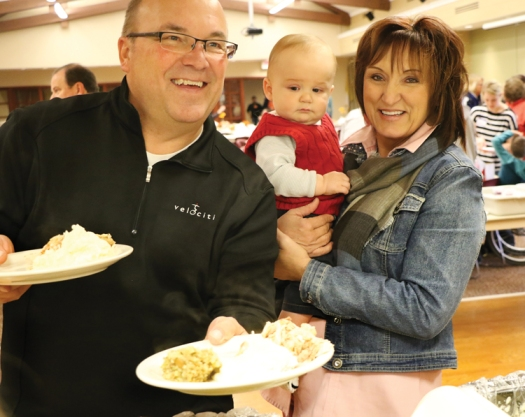 Allen and Margaret Stoltz with grandson Sawyer Uphoff.   the Uphoffs  bring Margaret's father Peter Volk to the dinner each year.  Peter who lives and Good Shepherd retirement home enjoys getting out and seeing family and friends.  This was the first Thanksgiving for grandson Sawyer.  Sawyer's parents Hope and Mark Uphoff also attended the dinner.