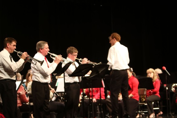 Trumpet trio Dwight Rose, Kirk Conyers and Ryan Beasley play Bugler's Holiday during the 20th Anniversry Blair Area Community Sunday in the Blair High School Auditorium.