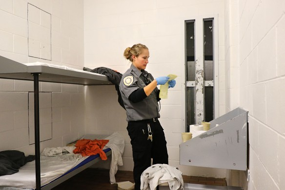 Washington County Jail corrections officer Shawna Brown searches a cell Saturday night during a cell search Saturday night while inmates are at rec time. Officers search the cell blocks periodically in a two week period.