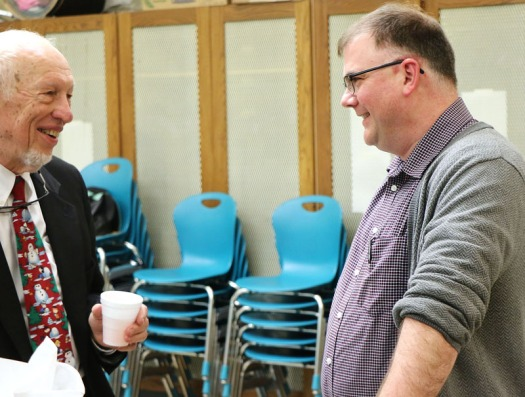 Founding Blair Area Community Band member Dr. Charles Bagby talks with music composer Noloan E. Schmit following the concert.  The musical selection Flatwater Sketches was commissioned by the Blair Area Community Band to commemorate the band's 20th anniversary.