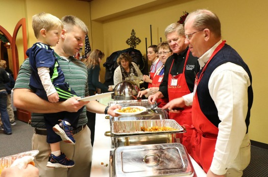 Washington County  area church pastors serve breakfast to Brad and son Brook at Chrstmas for the Coat.