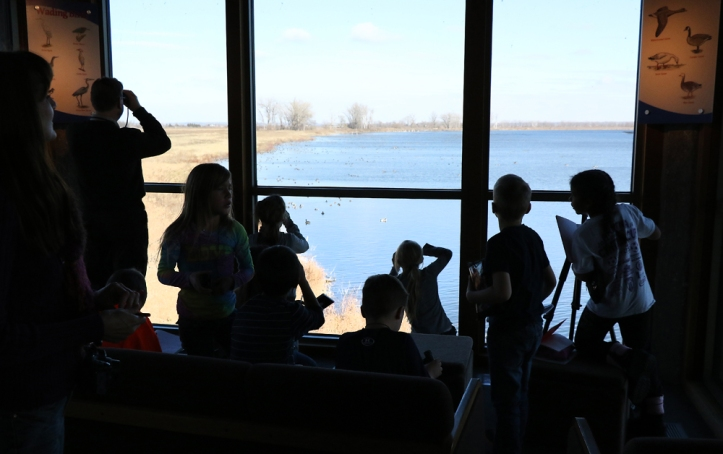 During a November field trip, South Third grade student observe ducks and geese from the windows in the DeSoto Bend Visitor's Center that overlook DeSoto Lake.
