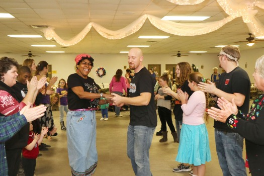 Eileen Justus and Matt Nelson sashay  down the line during a dance at the Barn Dance held at St. John's Schwertly Hall Saturday evening, Dec. 13