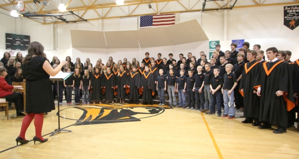 Junior and Senior  high choirs directed by Miss Stephanie Weaver perform on Dec. 16 at the Fort Calhoun High School gym