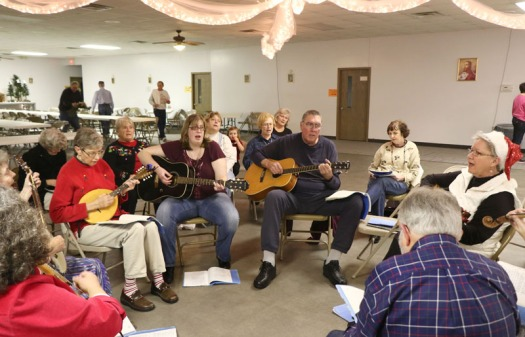 Audience sings along with the Rivertown String Band and Omaha Folk Music Society