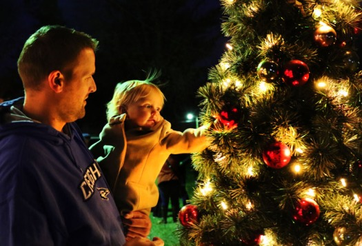 Joel Odvoddy and daughter Penelope in West Market Square in Fort Calhoun following tree lighting.