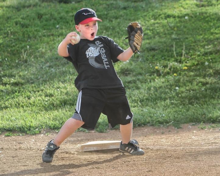 Karter Scott celebrates making the catch.