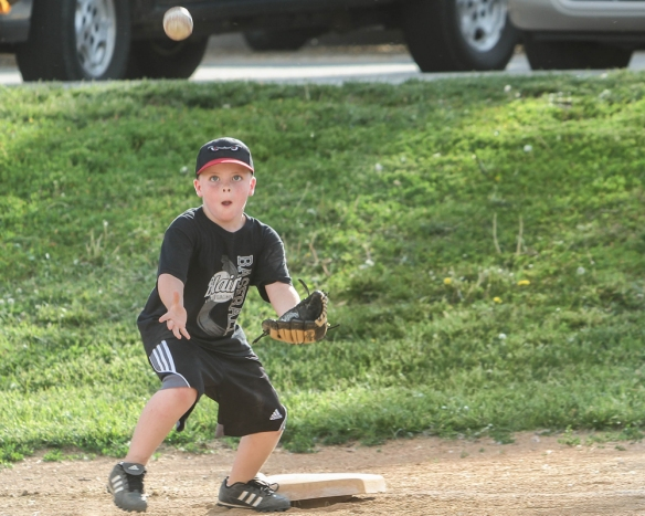 Little League player Kater Scott keeps his eye on the ball.