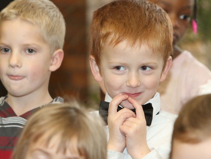 Students from North Primary School sing at the Washington Coujnty Bank on December 16. From left, Will Meier and Stephen Fear
