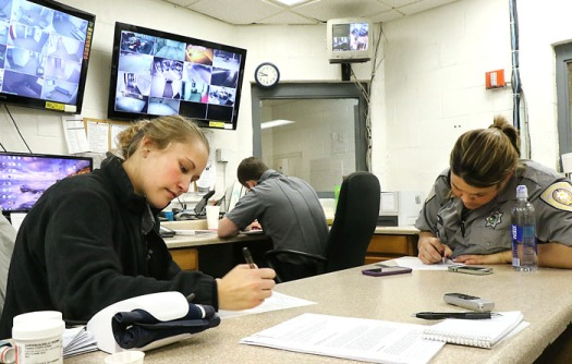 Washington County Jail corrections officers Shawna Brown, left, and Jenny Meyer fill out paperwork after completing a cell search. All searches must be documented, including any contraband that was found.