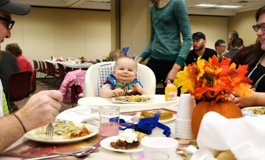 Ten month old Sawyer Uphoff celebrates his first Thanksgiving at the annual Thanksgiving Turkey dinner at St. Francis Borgia Catholic Church. The dinner which is put on by the Washington County Ministerial Alliance and Francs Borgia Catholic Church is free and open to all. Left overs are packaged and distributed by Joseph's Coat and the Washington County Food Pantry. With him are mom and dad Mark and Hope, grand parents Allen and Margaret Stoltz and great grand dad Peter Volk.