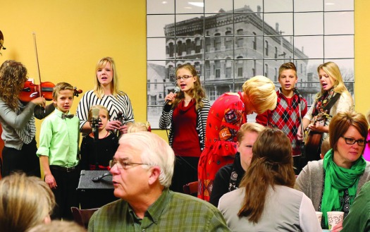 The Stangle family performs for a full house at Christmas for the Coat.