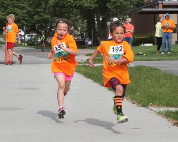 Laini Michaelis and Silas Bush sun side by side in a kids Triathlon sponsored by the Blair Family YMCA.