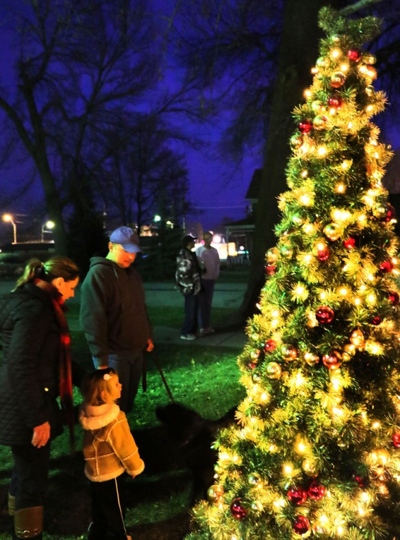Tricia and Brad Storey with daughter Leah following the tree lighting in West Market Square, Fort Calhoun.