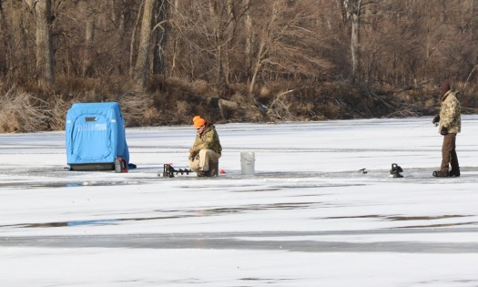 Tom Cox and Rod Hansen take some time off from work to try out the ice fishing on the opening day of ice fishing season at DeSoto NWR.