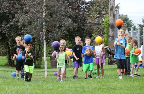 Chase Cottle ,carry balls on plungers,  fFrst grade fun day