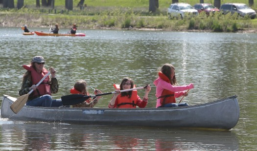 Parent Dana McCabe helps Maggie Valasek and Taylor McCabe paddle their canoe  during Outdoor Education day. at DeSoto National Wildlife Refuge.