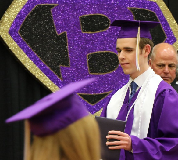 Chase Crispin, with diploma, Blair Commencement 2015
