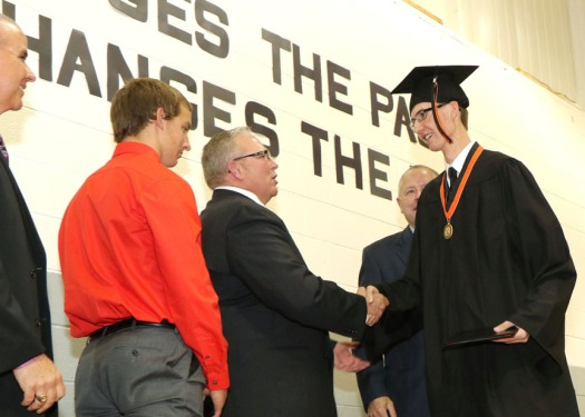 Netherlands Foreign Exchange student Remco Bakkar shakes hands with School Board President Mike Conrad.