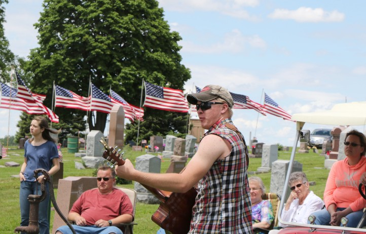 Grant Kubie sings patriotic themed songs during Memorial Day service at  Kennard on Monday afternoon.