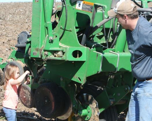 Hailey Andersen gives dad Jarrett Andersen a hand fixing the planter.