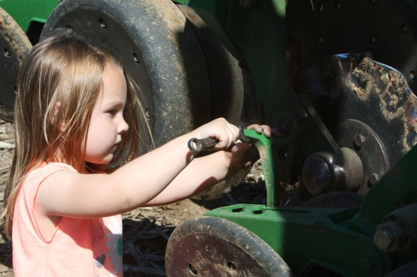 Hailey Andersen gives dad Jarrett Andersen a hand fixing the planter.