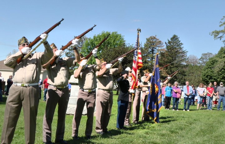 VFW Blair Post 1251 Honor Guard  fires 21 gun salute.  Memorial Day, Blair, Kennard From left: Les Miller, Jay Long, Joe Leonard, Bob Wittry, Carissa Stier, Deb Wehrili, Dave Brown, Ron Williby.