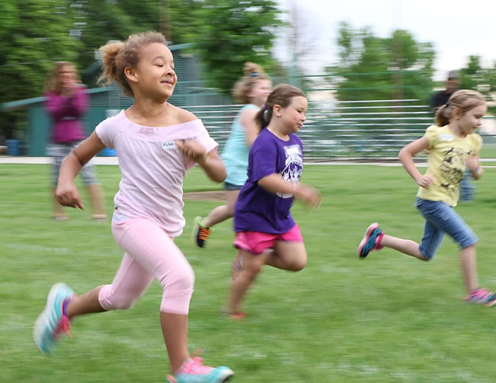Kylie Klingforth dashes toward the finish line.  First grade fun day