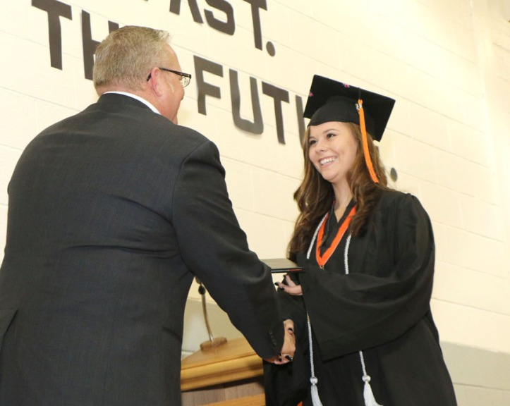 Michelle Dewitt receives diploman from School Board President Mike Conrad.