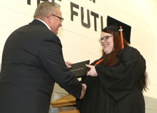 Emily Johnson receives diploma from Mike Conrad