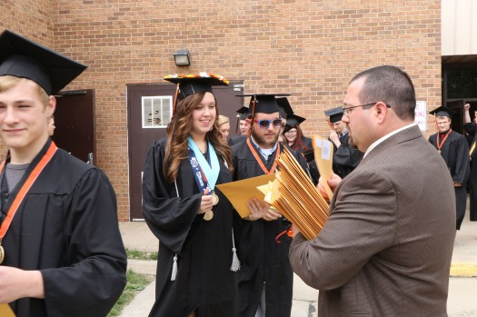 The real thing. Abigail Hillmer receives diploma packet from Assistant Principal Nick Wemhoff.