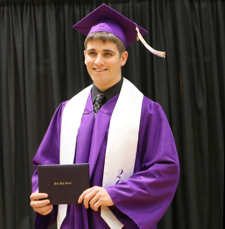 Riley Hancock, with diploma , Blair Commencement 2015