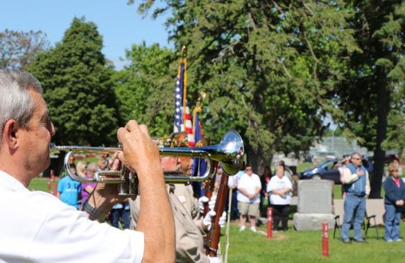 Ray Quadhammer plays taps following 21 gun salute by Blair VFW honor guard..  Memorial Day service at Blair cemetery.