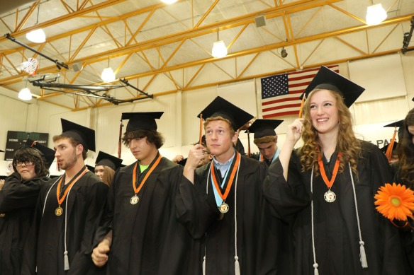 Fort Calhoun Graduation 2015   Fort Calhoun graduates from left  Brandi Woosley, Kyle Warthen, Jacob Volksen, Alex Tietz, Taylor Sutherland turn their tassels following  the diploma presentation. This will be the last time that  commencement exercises will be held in the old Fort Calhoun gymnasium.