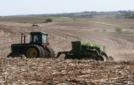 Jay Volk in  foreground and Lavonne Rolland in background planting soybeans east of CR 30 near CR 29 Saturday.  Volk hoped to finish up before May 1.