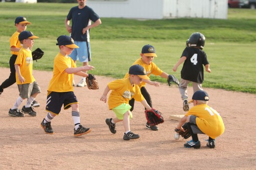 Tee ball. Burlington Bees swarm the ball to make the play.at second base.