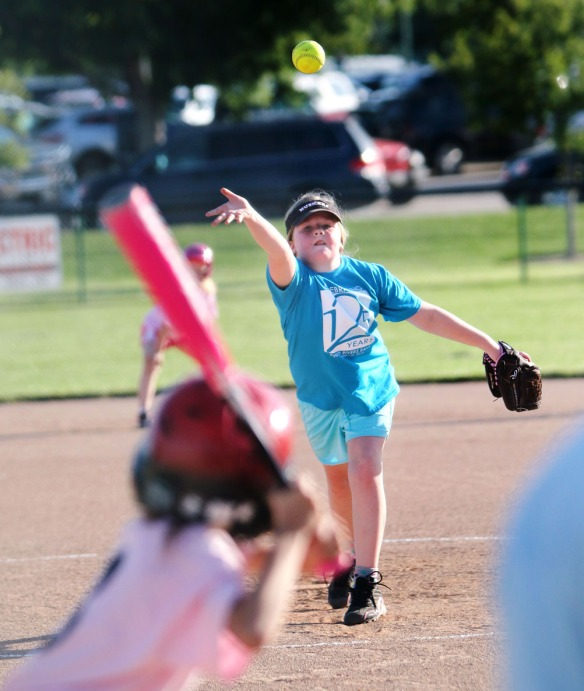 Haley Connor pitches for Two Rivers  Youth Softball grades 2-3 divan.