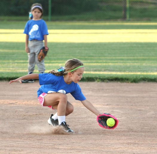 Lily Wibbels makes a catch  in the infield. K-1 division, Blair Youth Softball league