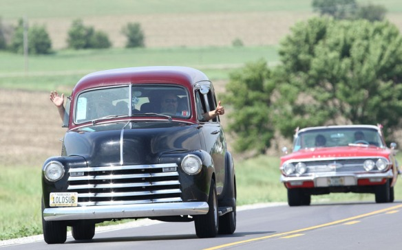 Early '50s Chevy Suburban Carry All  followed by red 1960 Chevy Nebraska Rod and Custom Association