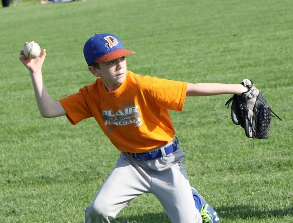 Outfielder Will Clarke throws the ball to first. Durham Bulls Rookie League Kid Pitch/Coach Pitch baseball.  (Rookies)