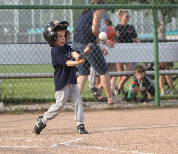 Zach Matney keeps his eye on the ball ,  Tee ball