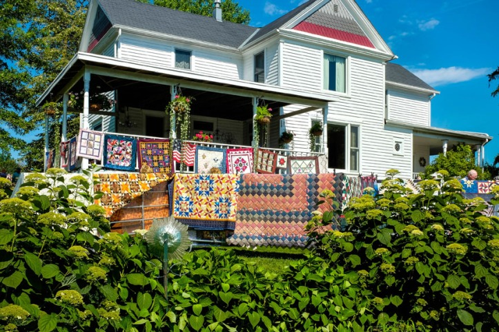 The home and gardens of  Dough and Teri Wolfe's home were layered with quilts during the Quilts in the Country quilt show and Garden tour on Saturday, July 18.