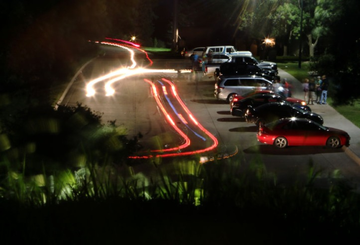 Some vehicles park while others cruise in and oput of Black Elk-Neihardt Park on a Friday evening. The park has become a controversial meeting place for area young adults.