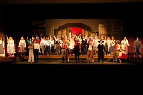 cast sings One Day More in the final scene of Les Miserables act one.